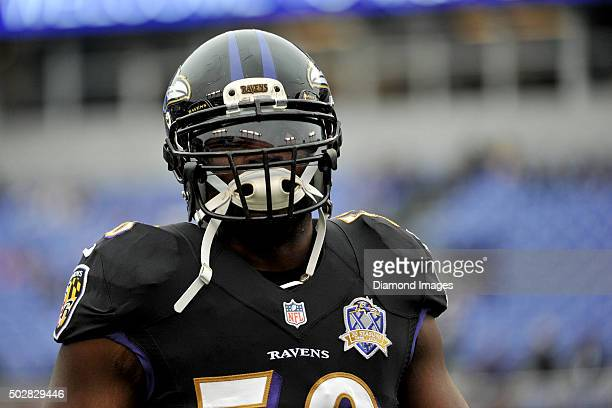 Linebacker Elvis Dumervil of the Baltimore Ravens walks onto the field prior to a game against the Pittsburgh Steelers on December 27 2015 at MT Bank...