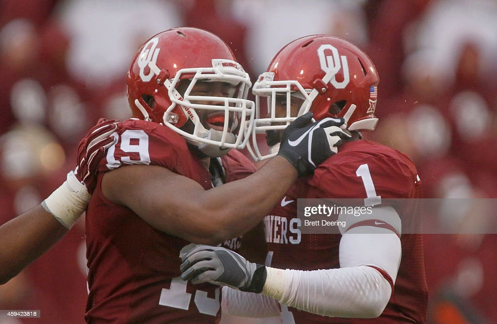 linebacker Eric Striker #19 and linebacker Dominique Alexander #1 of the Oklahoma Sooners celebrate a play against the Kansas Jayhawks November 22, 2014 at Gaylord Family-Oklahoma Memorial Stadium in Norman, Oklahoma. The Sooners defeated the Jayhawks 44-7.