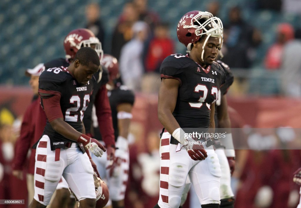 Linebacker Haason Reddick #33 and cornerback Ikeem Boyd #26 of the Temple University Owls walk off the field after losing to the University of Central Florida Knights catches a pass against the Temple University Owls on November 16, 2013 at Lincoln Financial Field in Philadelphia, Pennsylvania.