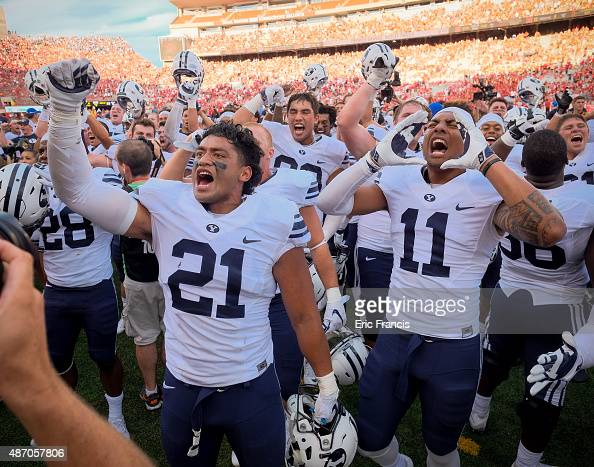 Linebacker Harvey Langi and wide receiver Terenn Houk of the Brigham Young Cougars and their teammates cheer to their fans after their game against...