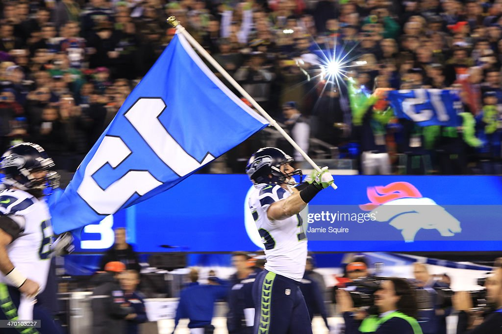 Linebacker Heath Farwell #55 of the Seattle Seahawks leads the team onto the field at start of Super Bowl XLVIII at MetLife Stadium on February 2, 2014 in East Rutherford, New Jersey.