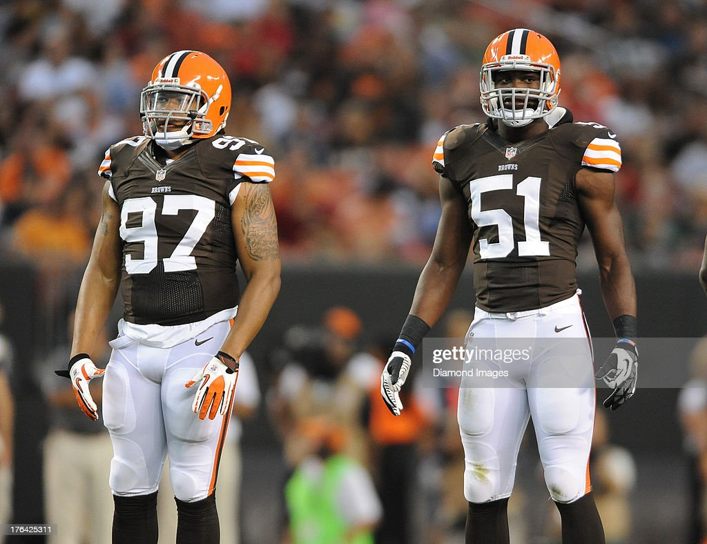 Linebacker Jabaal Sheard and Barkevious Mingo of the Cleveland Browns stand on the field before the snap of the football during a game against the St...