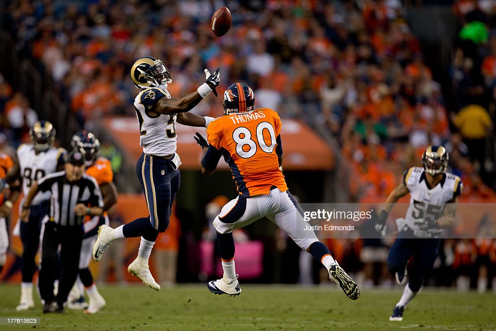 Linebacker Jabara Williams #52 of the St. Louis Rams intercepts a ball intended for Tight end Julius Thomas #80 of the Denver Broncos during a pre-season game at Sports Authority Field Field at Mile High on August 24, 2013 in Denver, Colorado.