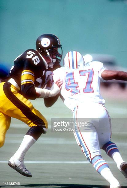 Linebacker Jack Lambert of the Pittsburgh Steelers hits Ronnie Coleman of the Houston Oilers during an NFL football game September 7 1980 at Three...