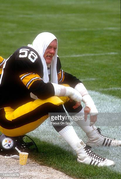 Linebacker Jack Lambert of the Pittsburgh Steelers looks on from the sidelines against the New Orleans Saints during an NFL football game November 25...