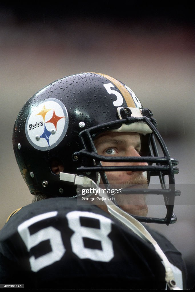 f1a6ba61 ... Autographed Steelers White Away Jersey w Lambert 58 Hologram in Cheap  Price on Linebacker Jack Lambert 58 of the Pittsburgh Steelers looks on  from the ...