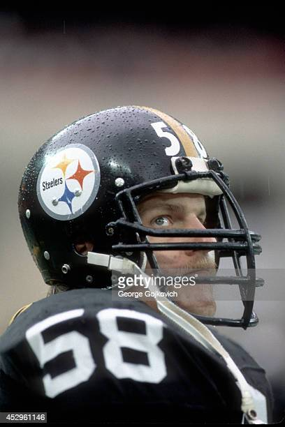 Linebacker Jack Lambert of the Pittsburgh Steelers looks on from the sideline during a game against the Houston Oilers at Three Rivers Stadium on...