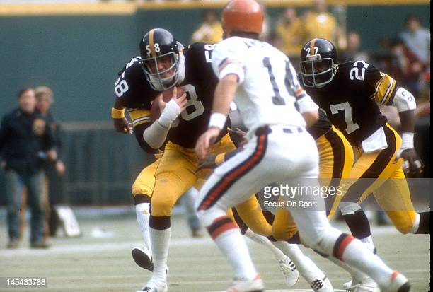 Linebacker Jack Lambert of the Pittsburgh Steelers runs with the ball after intercepting it against the Cincinnati Bengals during an NFL football...