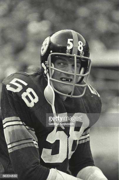 Linebacker Jack Lambert of the Pittsburgh Steelers watches the action from the bench during a game against the Cincinnati Bengals at Three Rivers...
