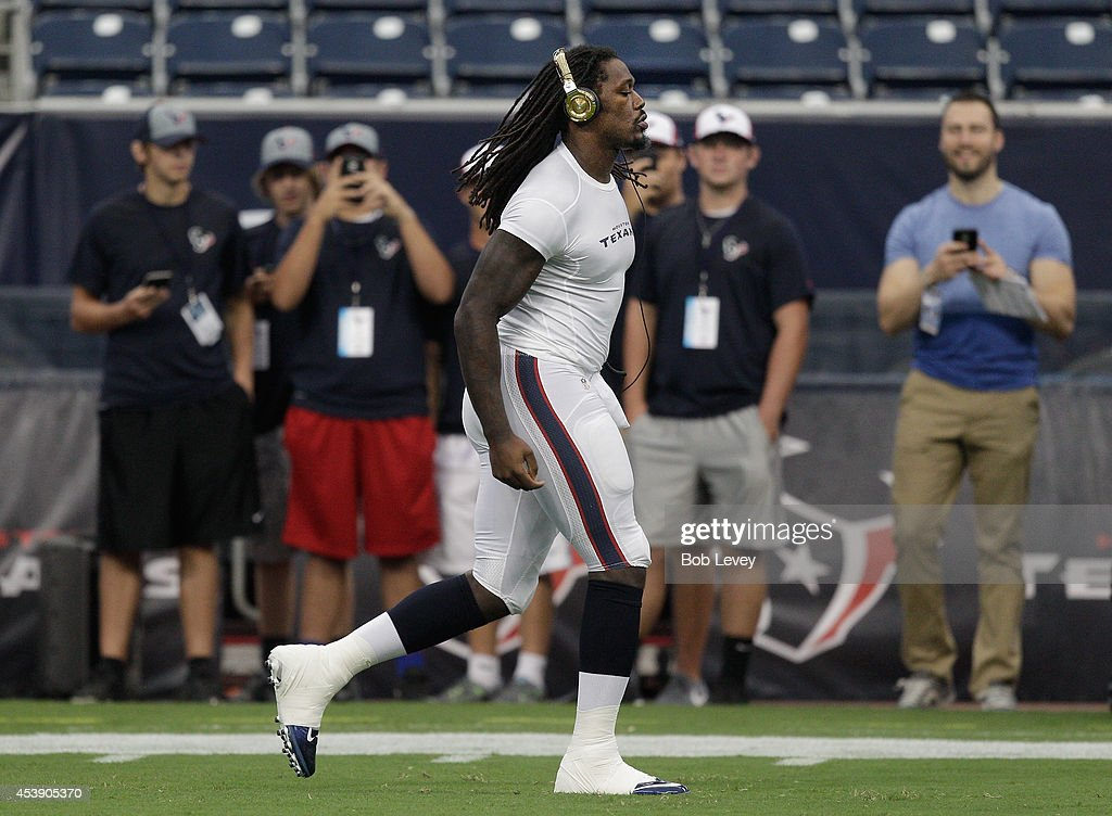 Linebacker Jadeveon Clowney #90 of the Houston Texans warms up before playing a preseason game against the Atlanta Falcons at Reliant Stadium on August 16, 2014 in Houston, Texas.