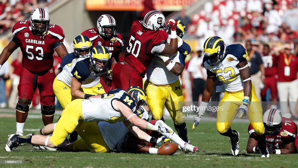 Linebacker Jake Ryan #47 of the Michigan Wolverines recovers a fumble from the South Carolina Gamecocks during the Outback Bowl Game at Raymond James Stadium on January 1, 2013 in Tampa, Florida.