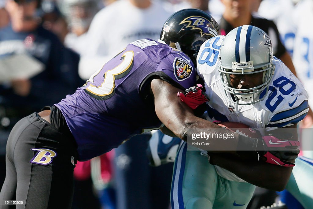 Linebacker <a gi-track='captionPersonalityLinkClicked' href=/galleries/search?phrase=Jameel+McClain&family=editorial&specificpeople=3954307 ng-click='$event.stopPropagation()'>Jameel McClain</a> #53 of the Baltimore Ravens tackles running back <a gi-track='captionPersonalityLinkClicked' href=/galleries/search?phrase=Felix+Jones&family=editorial&specificpeople=2130592 ng-click='$event.stopPropagation()'>Felix Jones</a> #28 of the Dallas Cowboys at M&T Bank Stadium on October 14, 2012 in Baltimore, Maryland.