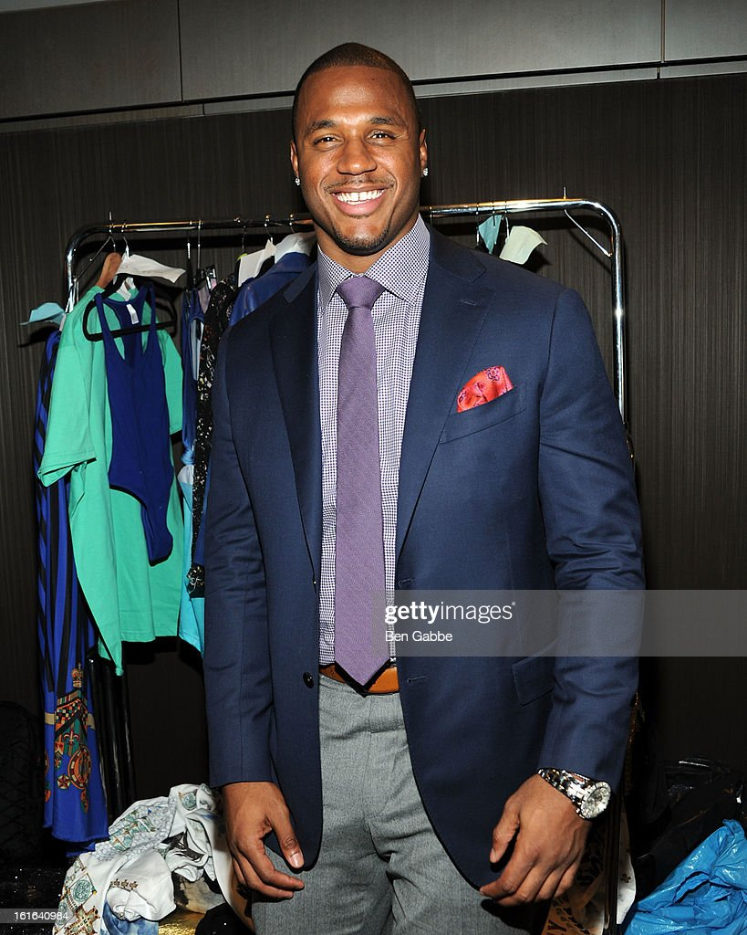Linebacker James Anderson poses backstage at the Indashio fall 2013 fashion during Mercedes-Benz Fashion Week at Grand Central Station on February 13, 2013 in New York City.