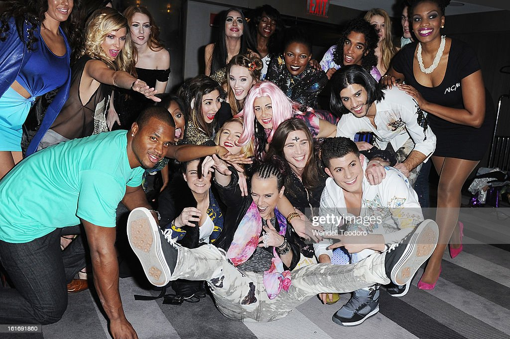 NFL Linebacker James Anderson poses with Fashion Designer (C) Indashio and his models backstage before the Indashio show during Fall 2013 Mercedes-Benz Fashion Week on February 13, 2013 in New York City.