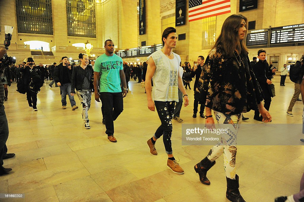 NFL Linebacker James Anderson walks through Grand Central Station during the Indashio show during Fall 2013 Mercedes-Benz Fashion Week on February 13, 2013 in New York City.