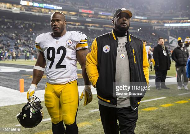 Linebacker James Harrison of the Pittsburgh Steelers and head coach Mike Tomlin walk off the field after a football game against the Seattle Seahawks...