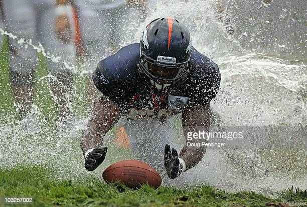Linebacker Jammie Kirlew of the Denver Broncos dives for the ball as rookies partake in the slip and slide fumble drill during training camp at Dove...