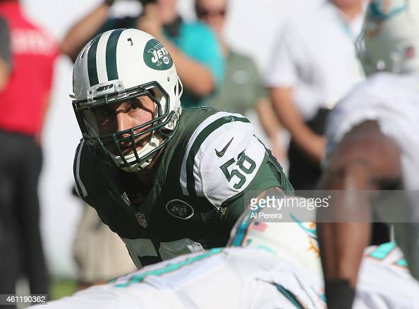 Linebacker Jason Babin of the New York Jets follows the action against the Miami Dolphins at Sun Life Stadium on December 28 2014 in Miami Gardens...
