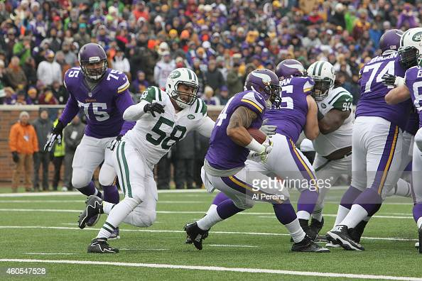 Linebacker Jason Babin of the New York Jets makes a stop against the Minnesota Vikings at TCFBank Stadium on December 7 2014 in Minneapolis Minnesota