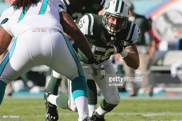 Linebacker Jason Babin of the New York Jets rushes against the Miami Dolphins at Sun Life Stadium on December 28 2014 in Miami Gardens Florida