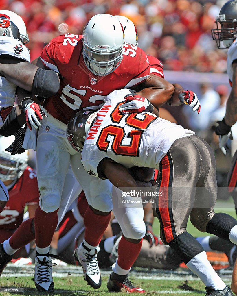 Linebacker <a gi-track='captionPersonalityLinkClicked' href=/galleries/search?phrase=Jasper+Brinkley&family=editorial&specificpeople=4032417 ng-click='$event.stopPropagation()'>Jasper Brinkley</a> #52 of the Arizona Cardinals tackles running back <a gi-track='captionPersonalityLinkClicked' href=/galleries/search?phrase=Doug+Martin+-+American+Football+Running+Back&family=editorial&specificpeople=9693143 ng-click='$event.stopPropagation()'>Doug Martin</a> #22 of the Tampa Bay Buccaneers September 29, 2013 at Raymond James Stadium in Tampa, Florida.