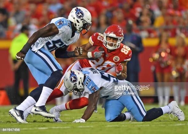 Linebacker Jayon Brown of the Tennessee Titans tackles tight end Ross Travis of the Kansas City Chiefs during the first half of a preseason game on...