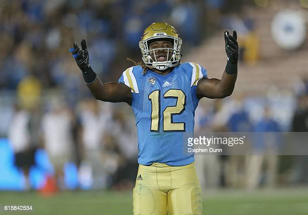 Linebacker Jayon Brown of the UCLA Bruins exhorts the crowd in the game against the UNLV Rebels at the Rose Bowl on September 10 2016 in Pasadena...