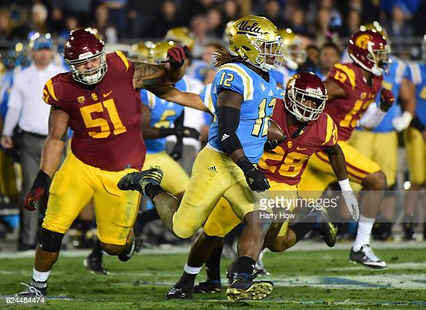 Linebacker Jayon Brown of the UCLA Bruins returns his interception during the second quarter against the USC Trojans at Rose Bowl on November 19 2016...