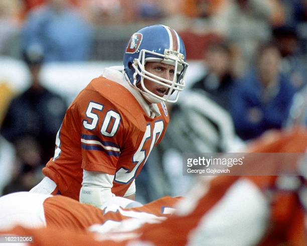 Linebacker Jim Ryan of the Denver Broncos looks on from the field during an AFC Divisional Playoff game against the Pittsburgh Steelers at Mile High...