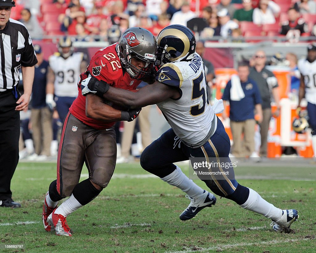 Linebacker Jo-Lonn Dunbar #58 of the St. Louis Rams tackles running back Doug Martin #22 of the Tampa Bay Buccaneers December 23, 2012 at Raymond James Stadium in Tampa, Florida.