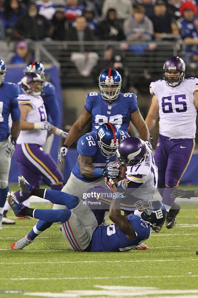 Linebacker Jon Beason of the New York Giants makes a stop against the Minnesota Vikings at MetLife Stadium on October 21 2013 in East Rutherford New...