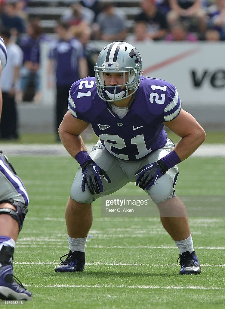 Linebacker Jonathan Truman #21 of the Kansas State Wildcats gets set on defense during the Purple and White Spring Game on April 27, 2013 at Bill Snyder Family Stadium in Manhattan, Kansas.
