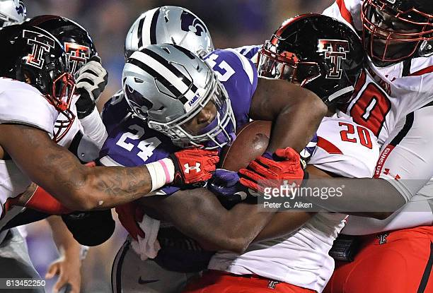 Linebacker Jordyn Brooks of the Texas Tech Red Raiders tackles running back Charles Jones of the Kansas State Wildcats during the second half on...