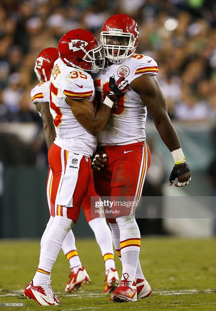 Linebacker Justin Houston #50 of the Kansas City Chiefs is hugged by teammate safety Quintin Demps #35 after recovering a fumble by quarterback Michael Vick #7 of the Philadelphia Eagles during the first quarter of a game at Lincoln Financial Field on September 19, 2013 in Philadelphia, Pennsylvania. The Chiefs defeated the Eagles 26-16.