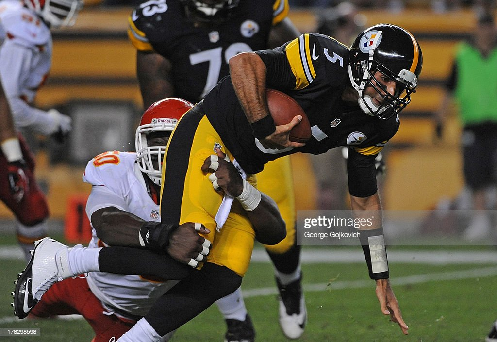 Linebacker Justin Houston #50 of the Kansas City Chiefs sacks quarterback Bruce Gradkowski #5 of the Pittsburgh Steelers during a preseason game at Heinz Field on August 24, 2013 in Pittsburgh, Pennsylvania. The Chiefs defeated the Steelers 26-20.