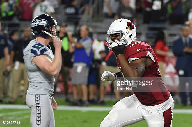 Linebacker Kareem Martin of the Arizona Cardinals and Jon Ryan of the Seattle Seahawks react after a missed field goal attempt during overtime of the...