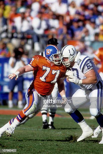 Linebacker Karl Mecklenberg of the Denver Broncos rushes against Will Wolford of the Indianapolis Colts during an NFL football game at Mile High...