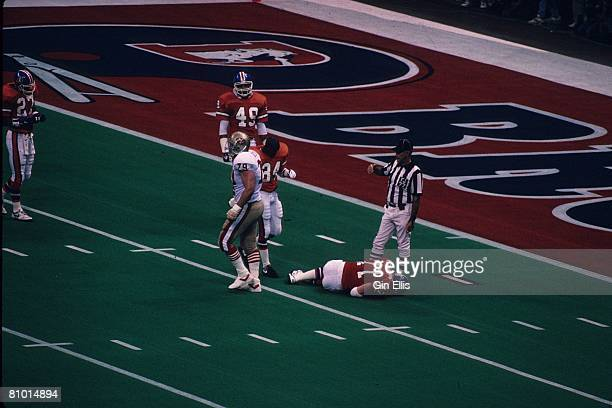 Linebacker Karl Mecklenburg of the Denver Broncos is down with a leg injury against the San Francisco 49ers in Super Bowl XXIV at the Superdome on...