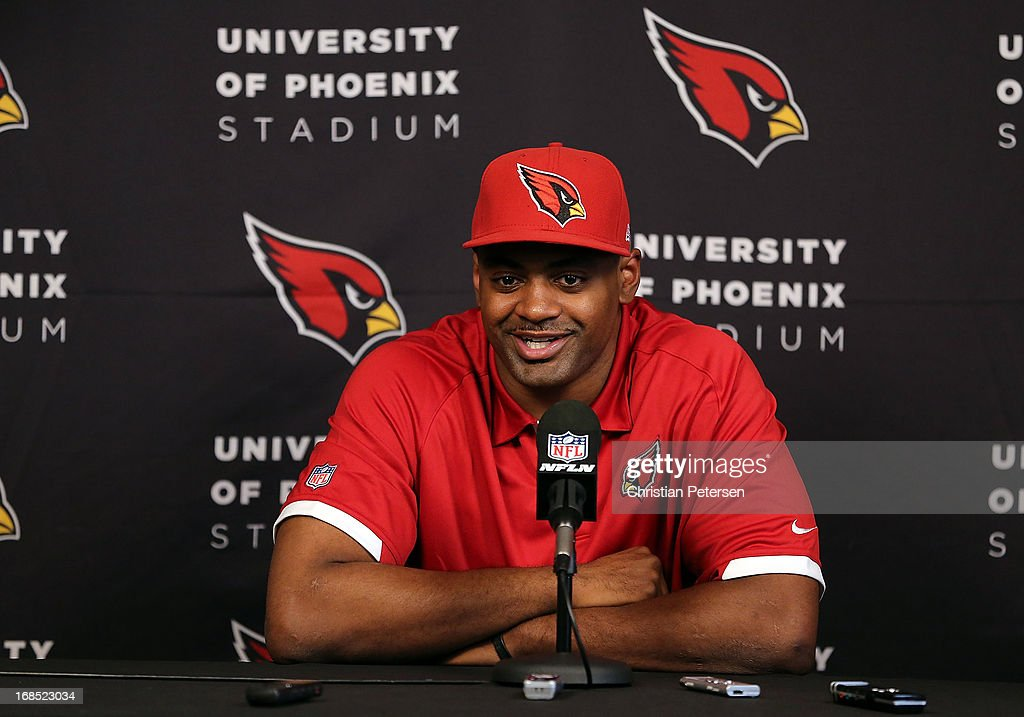 Linebacker <a gi-track='captionPersonalityLinkClicked' href=/galleries/search?phrase=Karlos+Dansby&family=editorial&specificpeople=233759 ng-click='$event.stopPropagation()'>Karlos Dansby</a> of the Arizona Cardinals speaks at the team's training center facility after signing a new one-year contract on May 10, 2013 in Tempe, Arizona.
