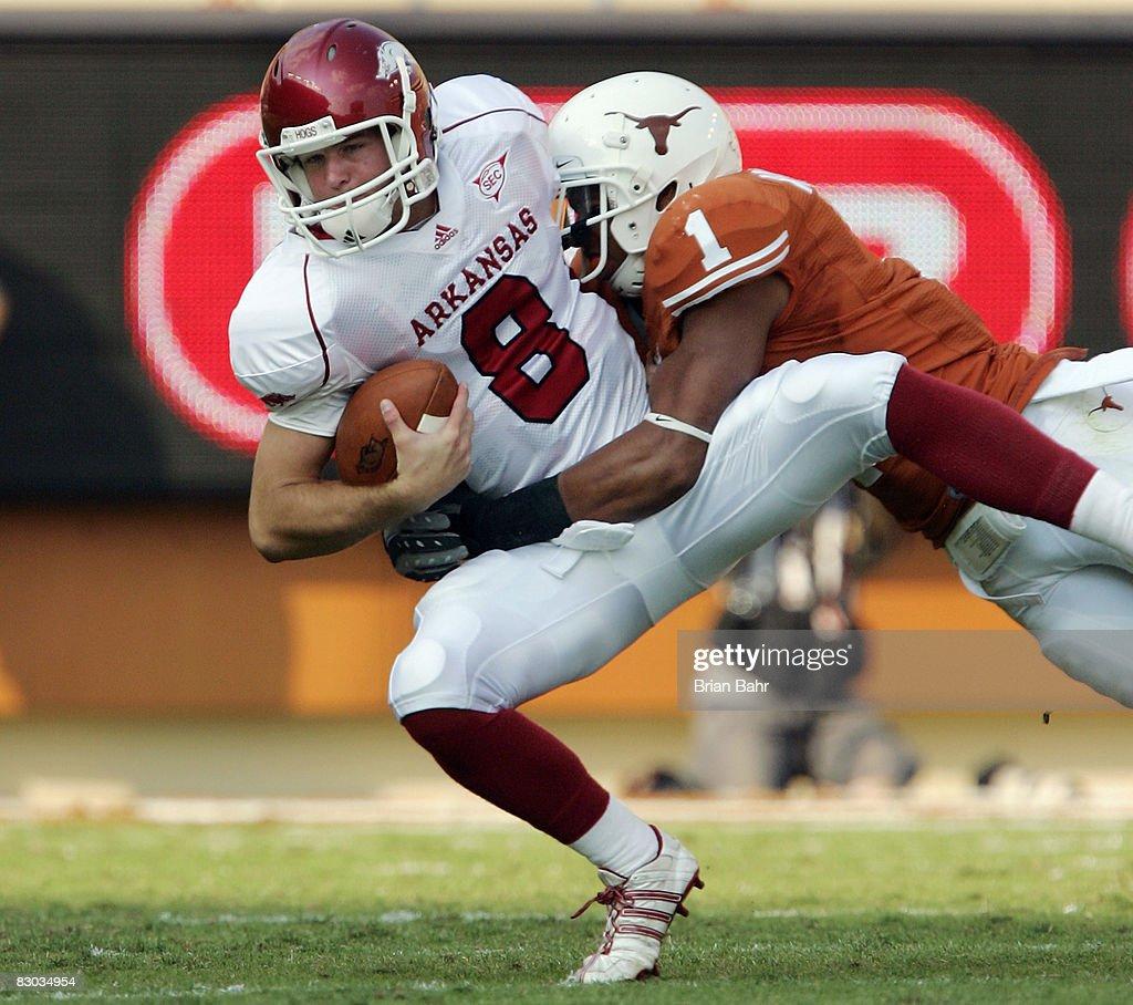 Linebacker Keenan Robinson of the Texas Longhorns sacks quarterback Tyler Wilson of the Arkansas Razorbacks in the fourth quarter on September 27...