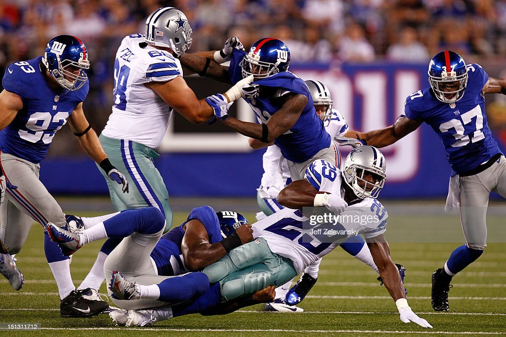 linebacker <a gi-track='captionPersonalityLinkClicked' href=/galleries/search?phrase=Keith+Rivers&family=editorial&specificpeople=695512 ng-click='$event.stopPropagation()'>Keith Rivers</a> #55 of the New York Giants tackles running back <a gi-track='captionPersonalityLinkClicked' href=/galleries/search?phrase=DeMarco+Murray&family=editorial&specificpeople=4489293 ng-click='$event.stopPropagation()'>DeMarco Murray</a> #29 of the Dallas Cowboys during the 2012 NFL season opener at MetLife Stadium on September 5, 2012 in East Rutherford, New Jersey.