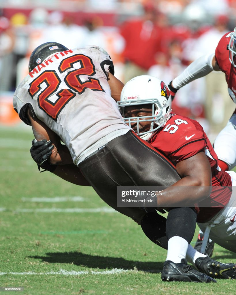 Linebacker Kenny Demens #54 of the Arizona Cardinals tackles running back Doug Martin #22 of the Tampa Bay Buccaneers September 29, 2013 at Raymond James Stadium in Tampa, Florida.
