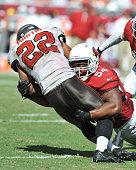 Linebacker Kenny Demens of the Arizona Cardinals tackles running back Doug Martin of the Tampa Bay Buccaneers September 29 2013 at Raymond James...