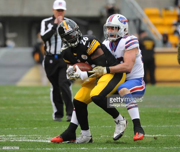 Linebacker Kiko Alonso of the Buffalo Bills tackles running back Le'Veon Bell of the Pittsburgh Steelers during a game at Heinz Field on November 10...