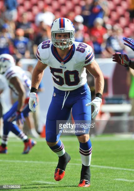 Linebacker Kiko Alonso of the Buffalo Bills warms up for play against the Tampa Bay Buccaneers December 8 2013 at Raymond James Stadium in Tampa...