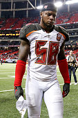 Linebacker Kwon Alexander of the Tampa Bay Buccaneers shows emotion as he walks off the field after the game against the Atlanta Falcons at the...