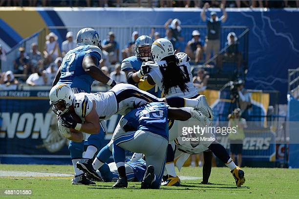 Linebacker Kyle Emanuel of the San Diego Chargers intercepts a pass attempt by quarterback Matthew Stafford of the Detroit Lions at Qualcomm Stadium...