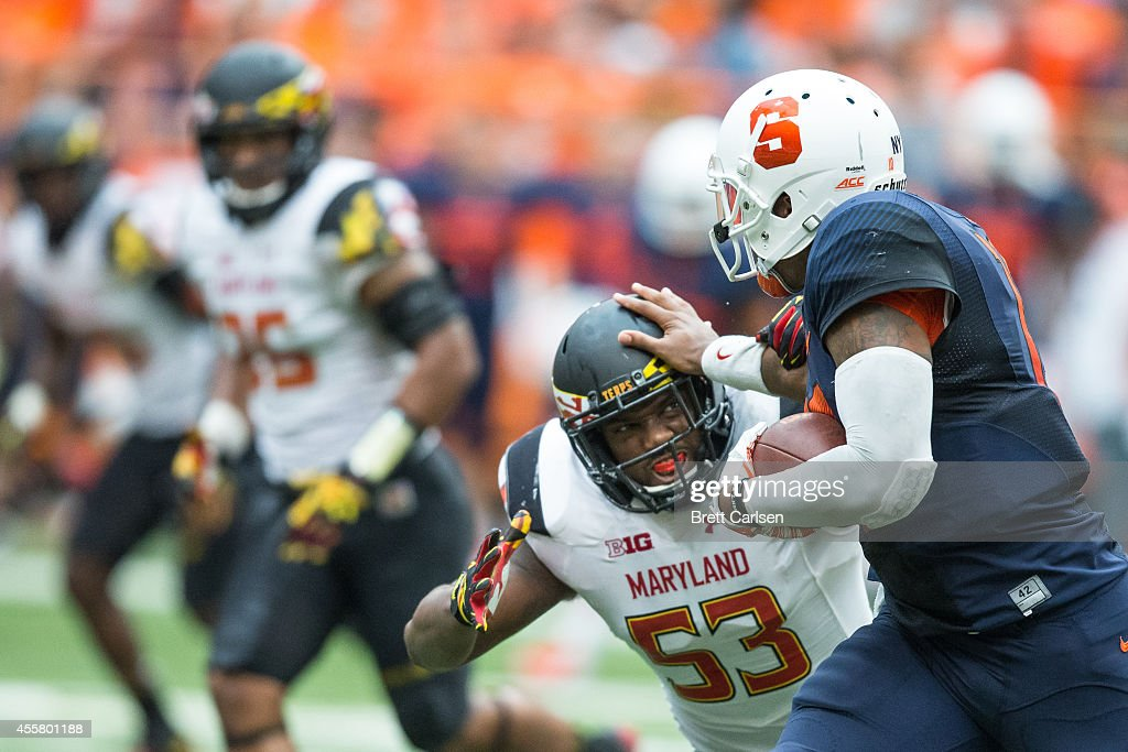Linebacker L.A. Goree #53 of the Maryland Terrapins is pushed out of the way by quarterback Terrel Hunt #10 of the Syracuse Orange during a first down quarter back keeper during the third quarter on September 20, 2014 at The Carrier Dome in Syracuse, New York. Maryland defeats Syracuse 34-20.