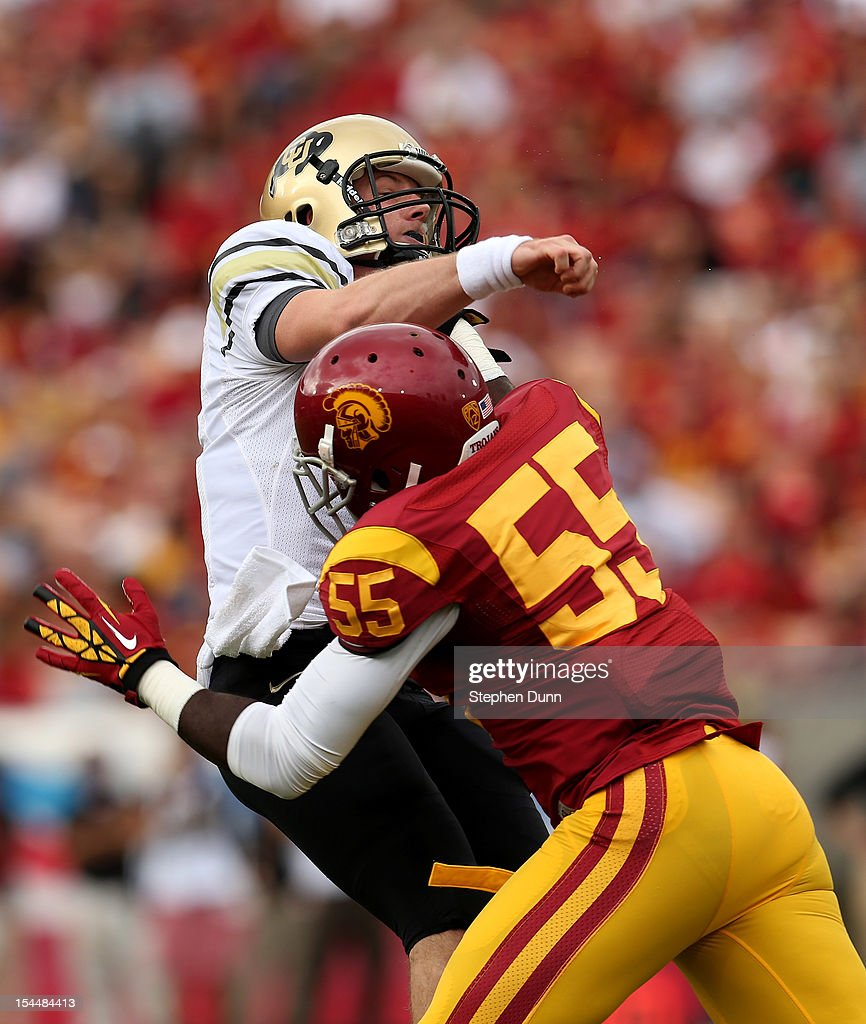 Linebacker Lamar Dawson #55 of the USC Trojans hits quarterback Jordan Webb #4 of the Colorado Buffaloes at the Los Angeles Memorial Coliseum on October 20,2012 in Los Angeles, California. USC won 50-6.