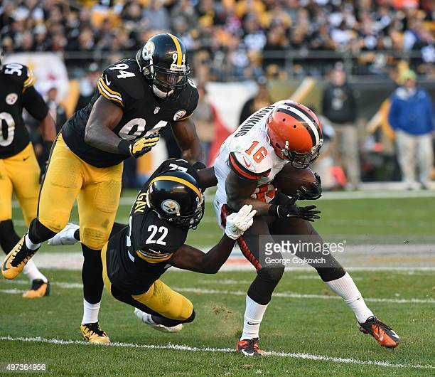 Linebacker Lawrence Timmons and cornerback William Gay of the Pittsburgh Steelers tackle wide receiver Andrew Hawkins of the Cleveland Browns during...
